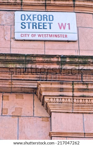 A sign on a street wall for Oxford Street in Central London