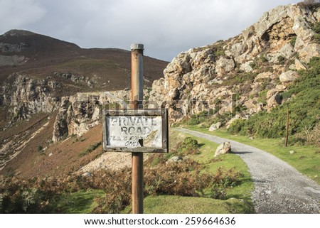 A sign post and path leading up to mountains near Conwy, North Wales - stock photo
