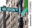 A sign post at the intersection of two streets reading VACATION DR and BEACH ST.  Remove the words and insert your own to easily customize the message. - stock photo