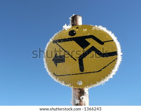 A sign shows the way to the cross-country track - stock photo