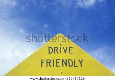 "A sign that reads ""?Drive Friendly""?"