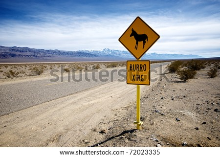 A sign warns careless travelers that donkeys may wander onto a lonely stretch of highway.