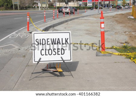A sign warns pedestrians that the sidewalk is closed during city construction/Sidewalk Closed and City Construction/Sidewalk is closed during city construction.