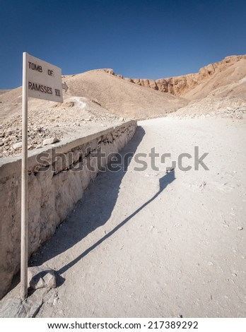 A signpost directing tourists to the tomb of Ramesses VII in the Valley of the Kings, Egypt.