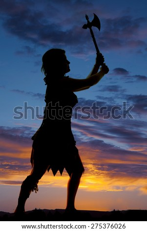 a silhouette of a cave woman with her hatchet up in the air.