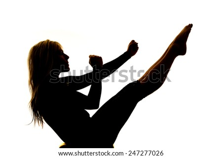 A silhouette of a woman doing an ab workout on a white background. - stock photo