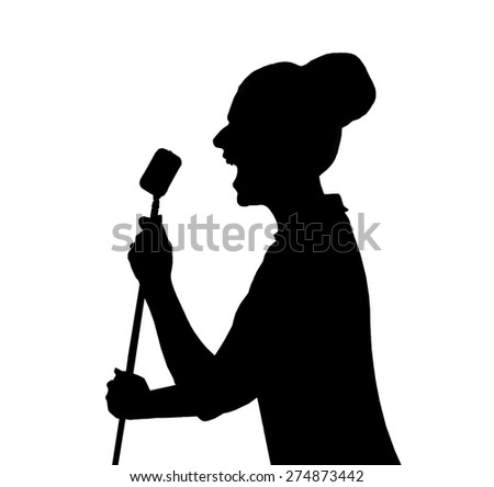 a silhouette of a woman in front of a microphone - stock photo