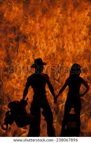 a silhouette of a woman with her cowboy holding on to each others hands. - stock photo