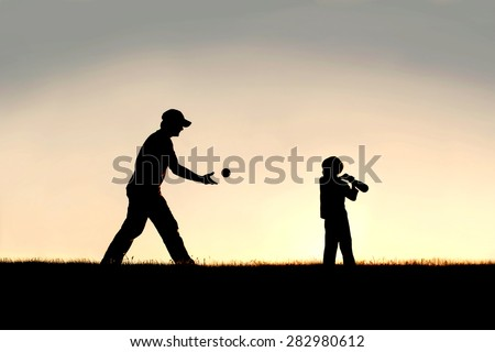 A silhouette of a young father and his little boy child playing baseball outside on a summer evening. - stock photo