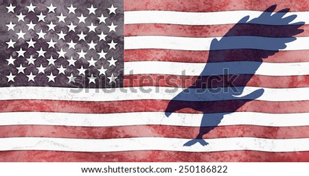 A silhouette of an eagle  flies across an american flag. The flag, with a grunge look, has wavy stars and stripes.