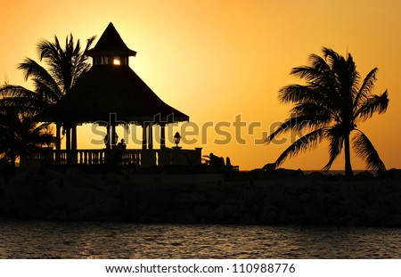 A Silhouette of Gazebo at Sunset, Jamaica - stock photo