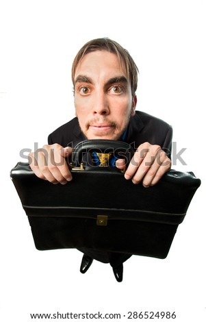 A silly guy ,with suit business, holding a briefcase isolated on white background - stock photo