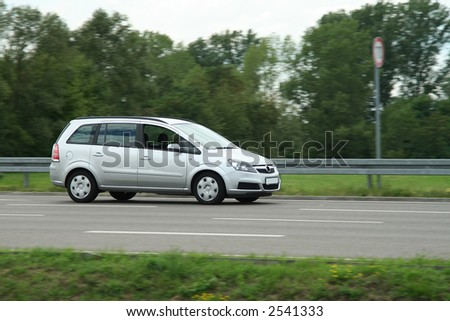 A silver van on the highway!