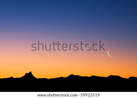 A simple desert landscape after sunset with plenty of copy space. - stock photo