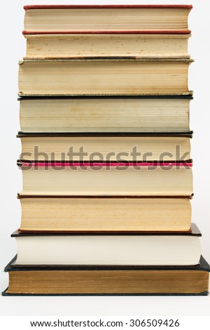 A simple yet eloquent pile of books. With a plain white background, this is a nice photo that has many educational applications for various ideas and concepts around the world.  - stock photo