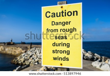 A sin on the English coast warning of rough seas in strong winds.