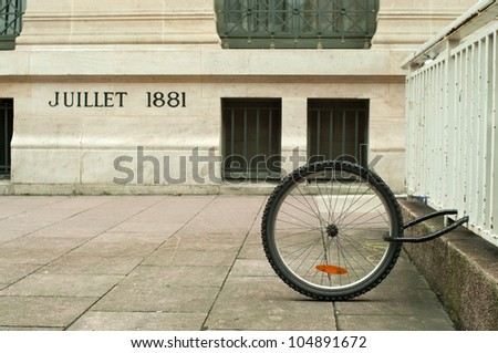 a single bicycle wheel on the street due to stealing - stock photo