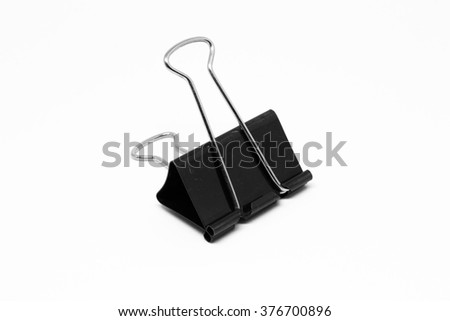 A single black paper clip on isolated white background