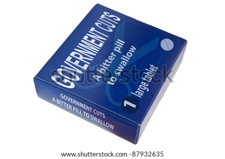 A single blue medication packagewith the words 'government cuts a bitter pill to swallow' arranged over white. - stock photo