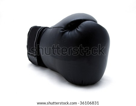 A single boxing glove on a white background. - stock photo