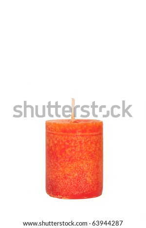A single burning red candle isolated in front of white background - stock photo