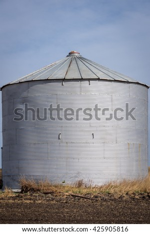 A single grain silo taking up the full picture frame - stock photo