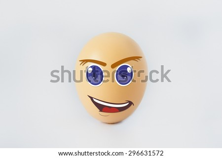 A single happy eggs with smiling faces. Isolated on a white background - stock photo