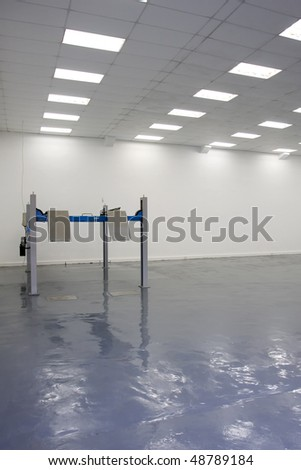 a single lift in car service garage with a blue floor ( equipment for diagnostics of car) - stock photo
