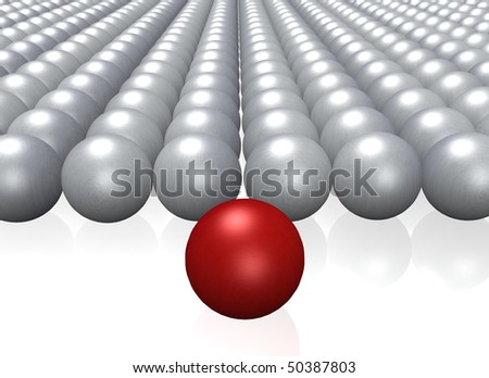 A single red ball among a crowd of grey balls. - stock photo