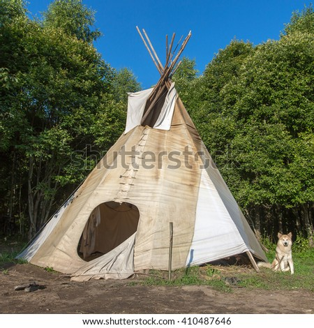 A single, solitary teepee in a forest. Tepees were traditional housing for Native Americans in Great Plains and other Western states. - stock photo