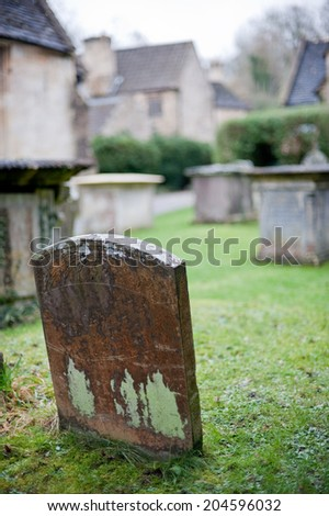 A single tombstone on an old english cemetery - stock photo