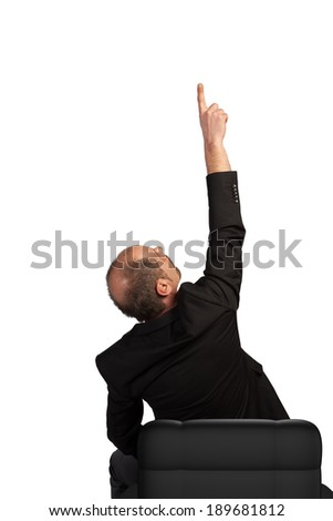 A sitting Manager is pointing his finger towards the sky isolated on a white background. - stock photo