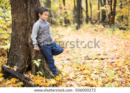 A Six years old child autumn season in a park