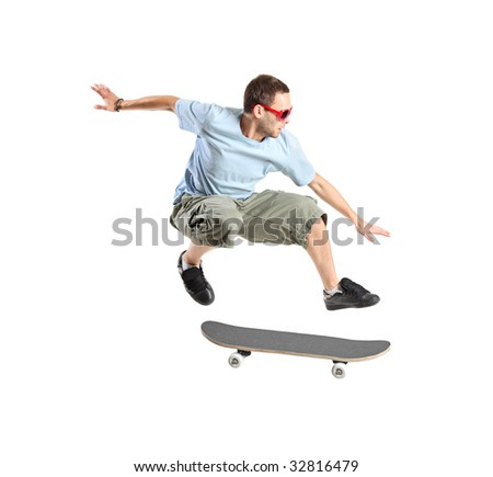 A skateboarder jumping isolated on a white background - stock photo