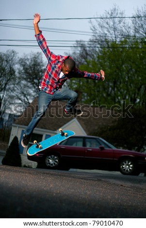 A skateboarder performing jumps or ollies on asphalt.  Slight motion blur showing the movement on the arms and legs. - stock photo