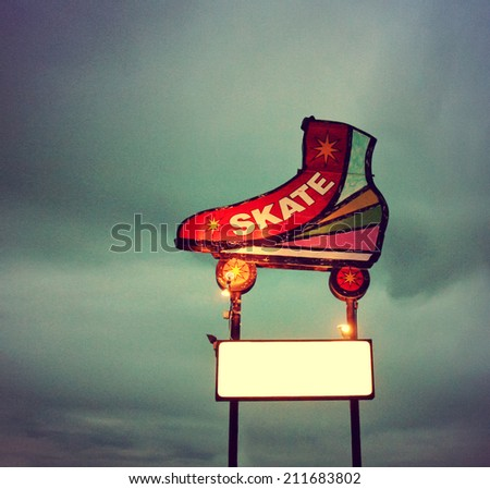 a skating neon sign toned with a vintage retro instagram filter - stock photo