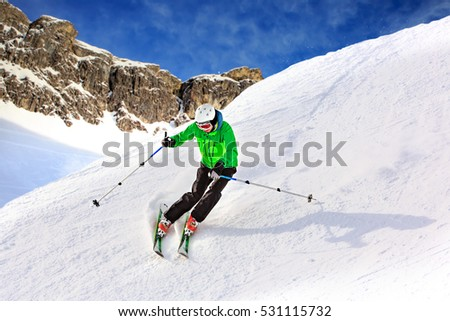 A ski driver on the piste in Alps by Lech, Austria.