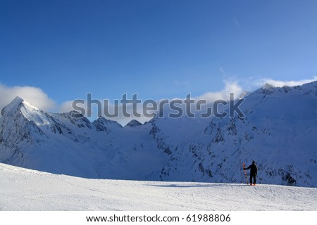 A skier takes a look over the ski boundary at Solden Austria, Winter 2010