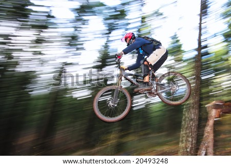 A skilled mountin biker leaps off of a jump near Hood River, Oregon.