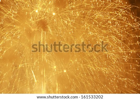 A sky lit up with exploding fireworks. - stock photo