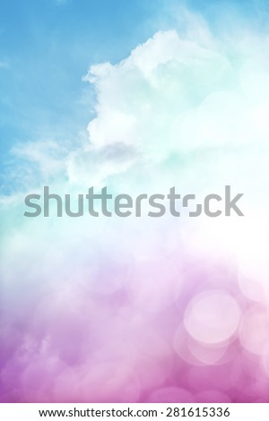 A sky scene with clouds, fog, and abstract bokeh effects.  Image also features a colorful purple to green gradient. - stock photo