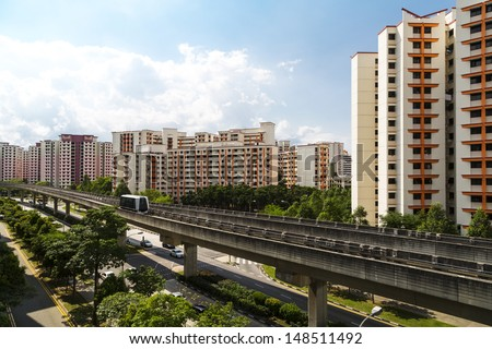 A sky train and track system in a modern neighborhood.  - stock photo