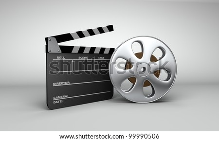 A slate clapboard and film reel with film setting next to each other