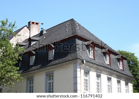 A slate roof with Windows and dormers
