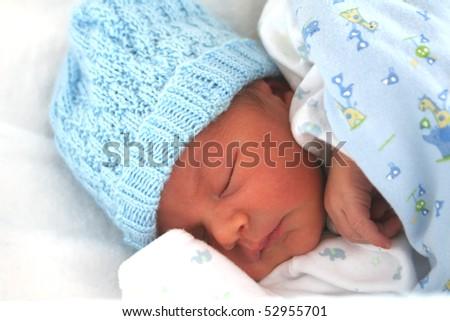 A sleeping newborn baby boy - stock photo