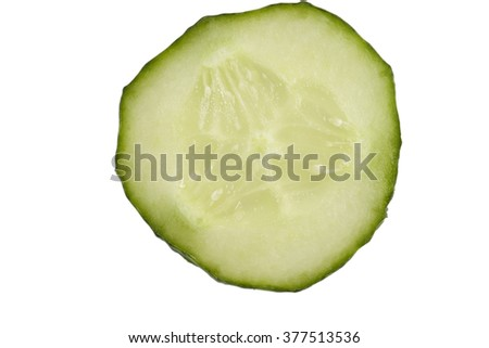 A slice of cucumber on the white