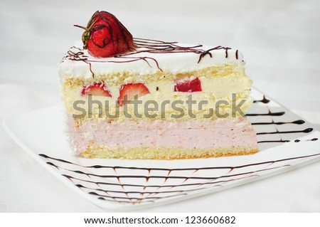 A slice of delicious cake on white background - stock photo