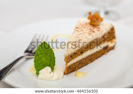 A slice of fresh carrot cake on a plate
