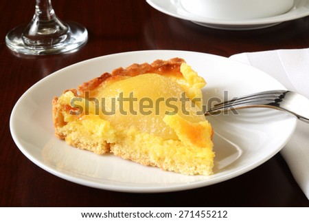A slice of gourmet pear tarte with almond custard filling - stock photo