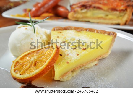 A slice of lemon tart on a plate  - stock photo